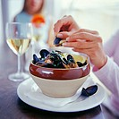 Eating mussels.
