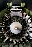 Aeroplane engine maintenance. Rear view of a Rolls Royce RB211 engine, which is used to power jumbo jet aircraft such as the Boeing 747. This is a tur...