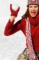 Young woman throwing a snowball (thumbnail)