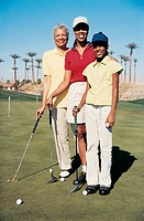 Portrait of a Grandmother, Mother and Daughter Standing on the Putting Green of a Golf Course