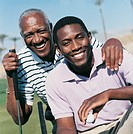 Portrait of a Father and Son on a Golf Course