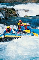 Four People Whitewater Rafting