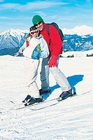 Portrait of a Smiling Father and Daughter on a Ski Slope