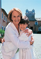 Grandmother Embracing Her Choirboy Grandson