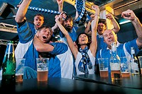 Group of Football Fans Celebrating in a Pub