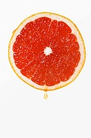 Grapefruit with drop of juice