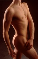 Torso of a nude Asian and Caucasian male.