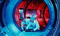 Technicians inside the Tokamak Fusion Test Reactor (TFTR), Princeton Plasma Physics Laboratory (NJ). This record-setting reactor was used in the large...