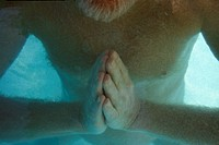 Close-up of Harold Dull practicing watsu water therapy in a pool at Harbin Hot Springs, near San Francisco, California.