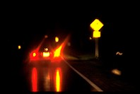 Blurred view of a car´s brake lights at night.