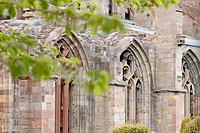 Windows in the fifteenth century ruins of Melrose Abbey. Scottish Borders, Scotland