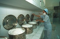 A HOSPITAL IN ASIA<BR>Tu Du maternity ward in Saigon, Vietman. Sterilization of compresses.