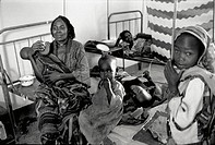MEDECINE TCHAD<BR>Photo essay.<BR>Family at hospital.  Since 1997, Mario (obstetrician/pediatrician) and Ambrogio (surgeon) have revived an abandoned ...
