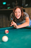 girl shooting pool