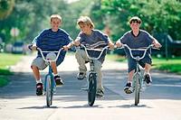three kids riding their bikes