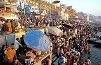 Hindu pilgrims washing in the holy Ganges river. Varanasi, India