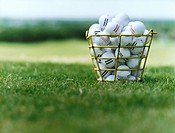 Basket of Golf Balls on Golf Course