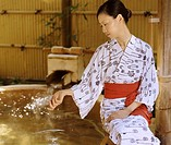 Woman Checking the Water of an Onsen