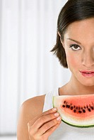 Portrait of a Young Woman Holding a Slice of Watermelon