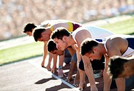 Young male athletes in starting position (thumbnail)