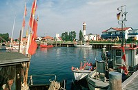 Fishin boats in harbour at the Baltic Sea and lighthouse. Timmendorf, Island Pohl. Mecklenburg Western Pommerania, Germany