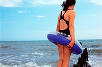 Girl standing near sea (thumbnail)