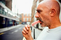 Man eating an ice lolly