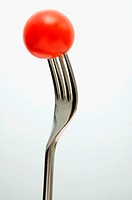 Cherry tomato on a fork (thumbnail)
