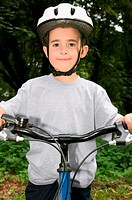Boy wearing a bicycle helmet