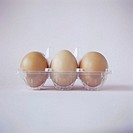 Three eggs in a plastic egg carton. Eggs are a good dietary source of protein, but also contain high levels of cholesterol.