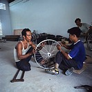 Wheelchair workshop. Technicians working in a wheelchair assembly workshop in Cambodia. They have been trained by the Motivation Charitable Trust, whi...