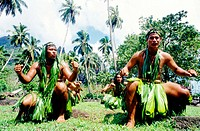 Local men and women performing the traditional Pig Dance in Hatiheu. Nuku-Hiva island. Marquesas archipelago. French Polynesia