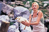 woman with a white dress and a goose