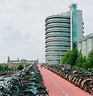 Rows of bikes at train station. Amsterdam. Holland