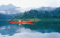 Thailand, Khao Sok National Park, wildlife viewing from kayak with binoculars