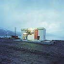 Small, old petrol station by the sea at Djupavik in the Westfjords