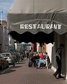 A street cafe by a restaurant