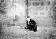 A poor man on a pavement