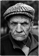 An angry looking elderly man