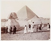 A snapshot photograph of  tourists at the Sphinx, Egypt, taken by an unknown photographer in about 1905. A group of European tourists, accompanied by ...