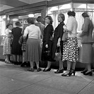 Passengers buying ferry tickets at Ocean Terminal, Southampton, 1950.  This terminal is where people arrived to take ocean liners to the USA. At this ...