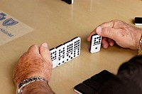 In Little Havana in Miami Florida on Calle Ocho in the afternoons, playing dominoes