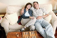 Couple with backgammon game, portrait