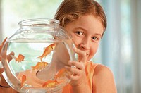 Girl with goldfish bowl, portrait
