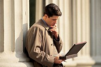 Businessman outdoors on laptop