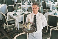 Waiter with wine, portrait