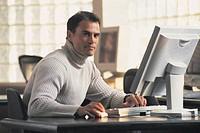 Man at computer, portrait