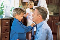 Boy adjust man´s tie