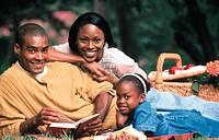 Family enjoying a picnic, portrait