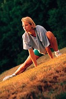 Woman stretching outside, tilted angle